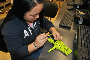 Student tying the hand parts together