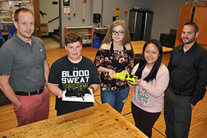 Students hold the completed prosthetic hands