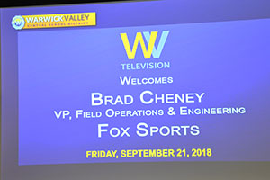 Screen with info about WVHS alum speaker, Brad Cheney