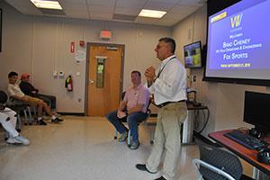 CTE Video Production teacher Dan Cecconie introduces alum guest speaker, Brad Cheney