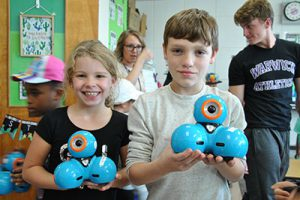 "HS & elementary students ""buddy up"" for a hands-on robotics lesson"