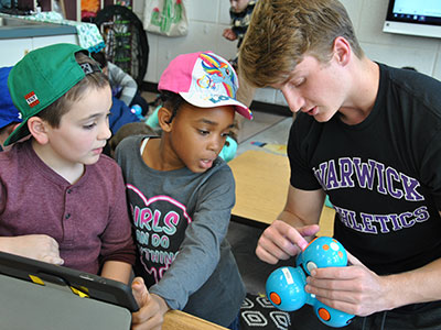 WVHS and PA students work together on a robotics project.