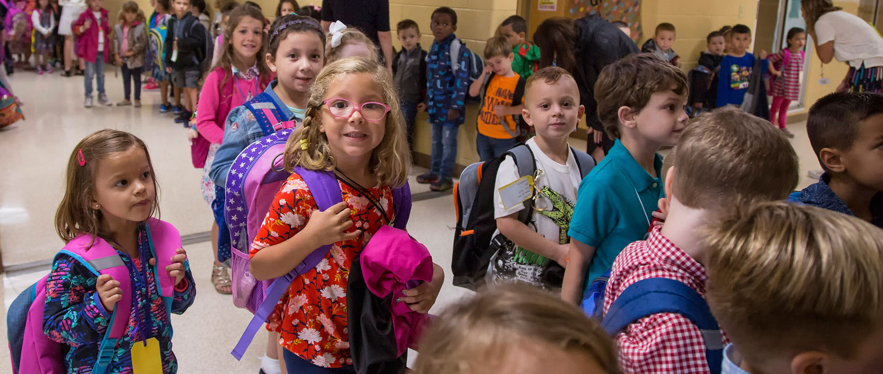 a school hallway of kindergarten students on the first day of school