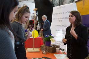 students speak with an exihibotor at the career fair