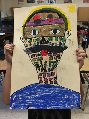 An  art student holds a self portrait in front of his face