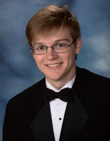 A portrait of a high school boy in a tuxedo