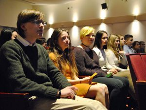 A group of students sitting in the front of the auditorium.