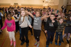 Four students, in profile at the Park Avenue Elementary , dancing and jumping