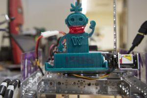 A plastic blue robot man