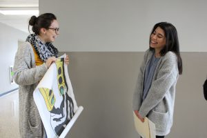Naya Vasquez being presented with an enlargement of her winning artwork
