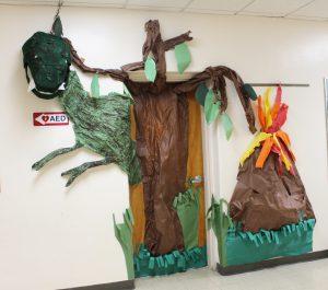 Classroom door decorated with dinosaur art