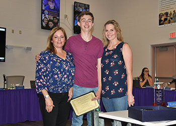 Laura Kelly, WVHS PTSA President (left) and HS Art Teacher Kristen Spano present Patrick Gardiner (Grade 9) with a PTA Reflections art award 2019. Ptrick was a WVHS local winner.