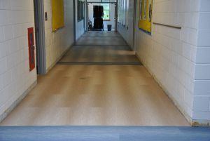 View of replaced flooring in school hallway.