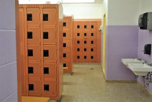 View of fresh-painted orange lockers.