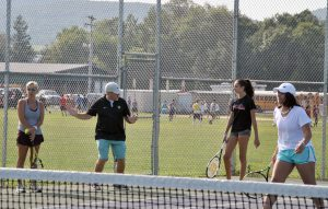 Coach advising a player