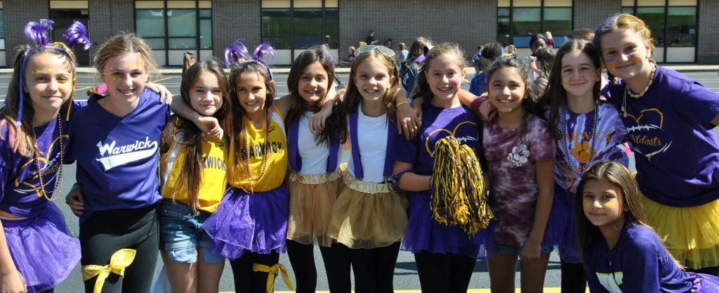 students dressed in purple in gold