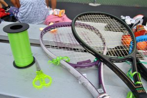 Close up of two tennis rackets with green ribbon