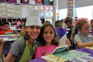 Teacher with student at book tasting