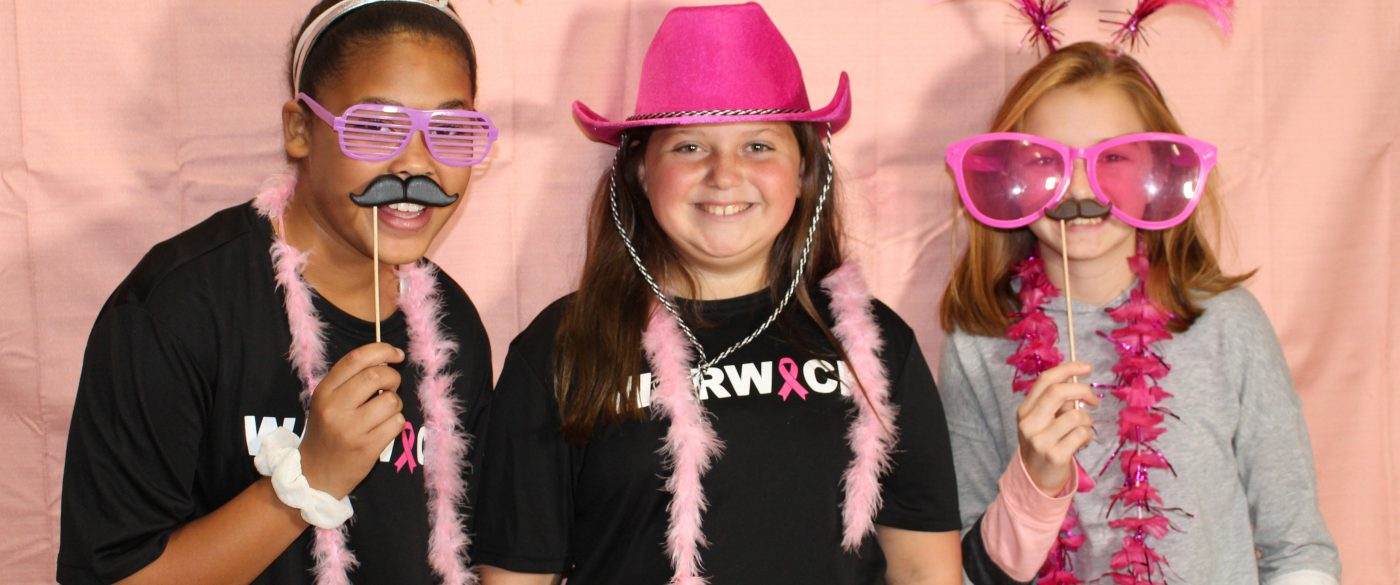 students at a photo booth