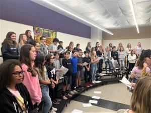 A chorus class singing