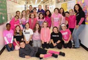 middle school students dressed in pink