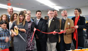 a selection of people cutting a ribbon