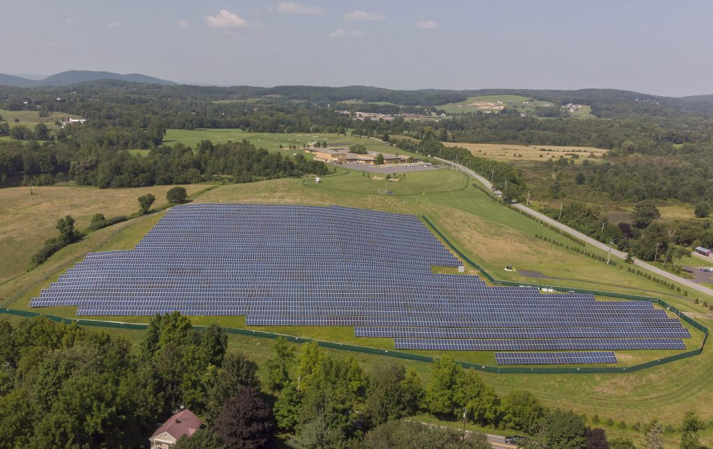 The district's solar array is located on a field downhill from Sanfordville Elementary.