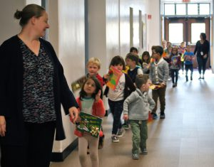 kindergarteners with their books on parade