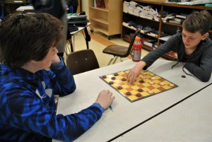 Two students playing checkers