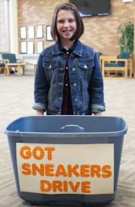 Fiona with her Got Sneakers box