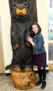 Fiona with wooden bear school mascot