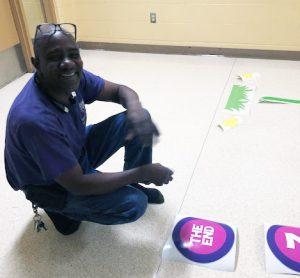 man installing vinyl decals