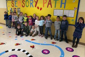 Happy students are thrilled to explore Sanfordville Elementary's new Sensory Path Hallway