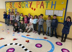 students in the sensory path hallway