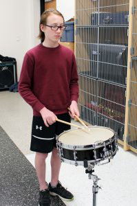 Owen Machingo playing drums