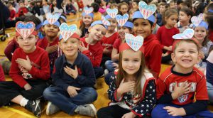 Cute kindergarteners wearing festive hats