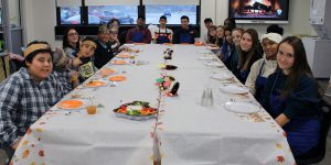 Students having a thanksgiving lunch at the middle school