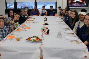 High school's 'Taste of Culinary' class students prepare Thanksgiving meal for a very special middle school class
