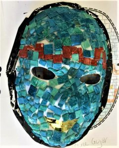 A mask designed with small tiles of different colors.