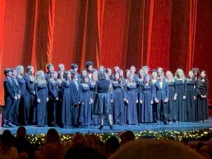 Choir singing on stage.