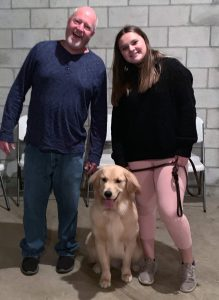 Jim Epperly and Maggie Schloika with a dog