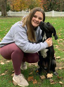 Maddie with a black lab dog