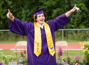 A WVHS student celebrates during graduation.
