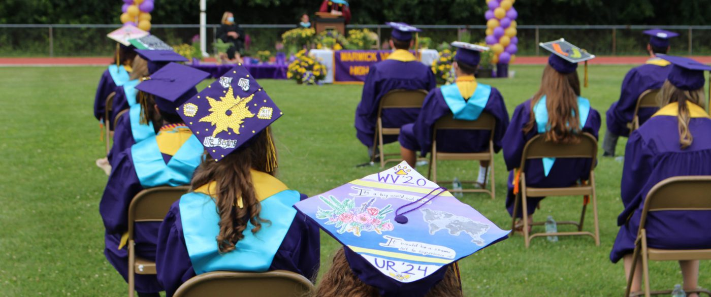 Students listen to Dr. Leach during graduation.