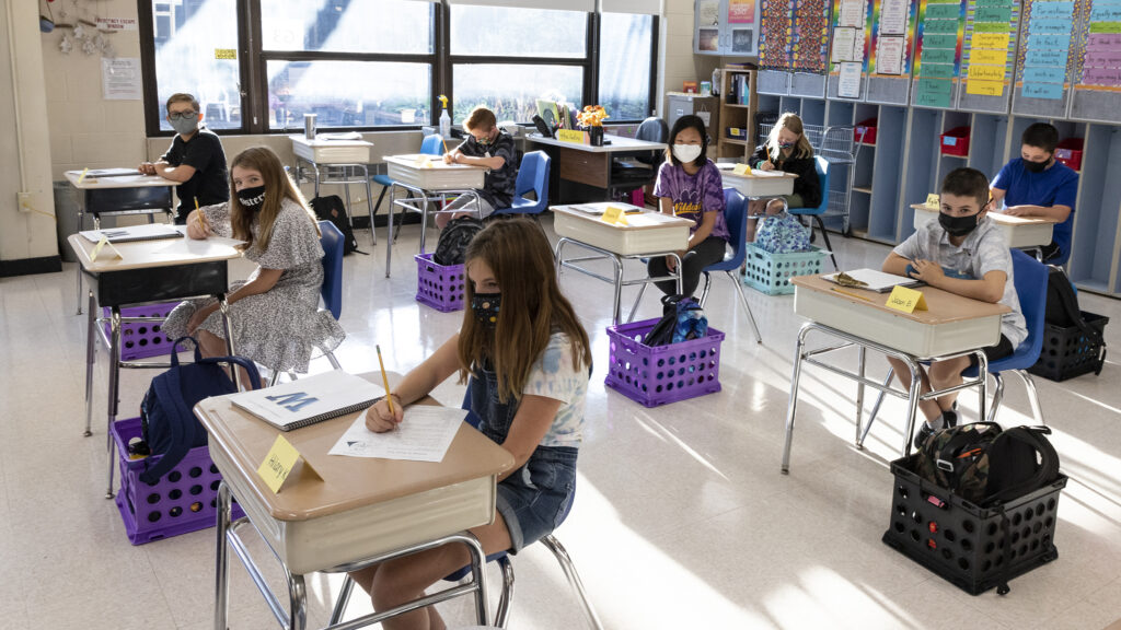 Students attend class on the first day of school at Warwick Middle School