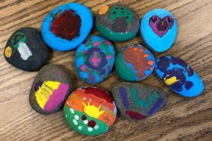 PIE 3-4 students' painted rocks going to Yuma
