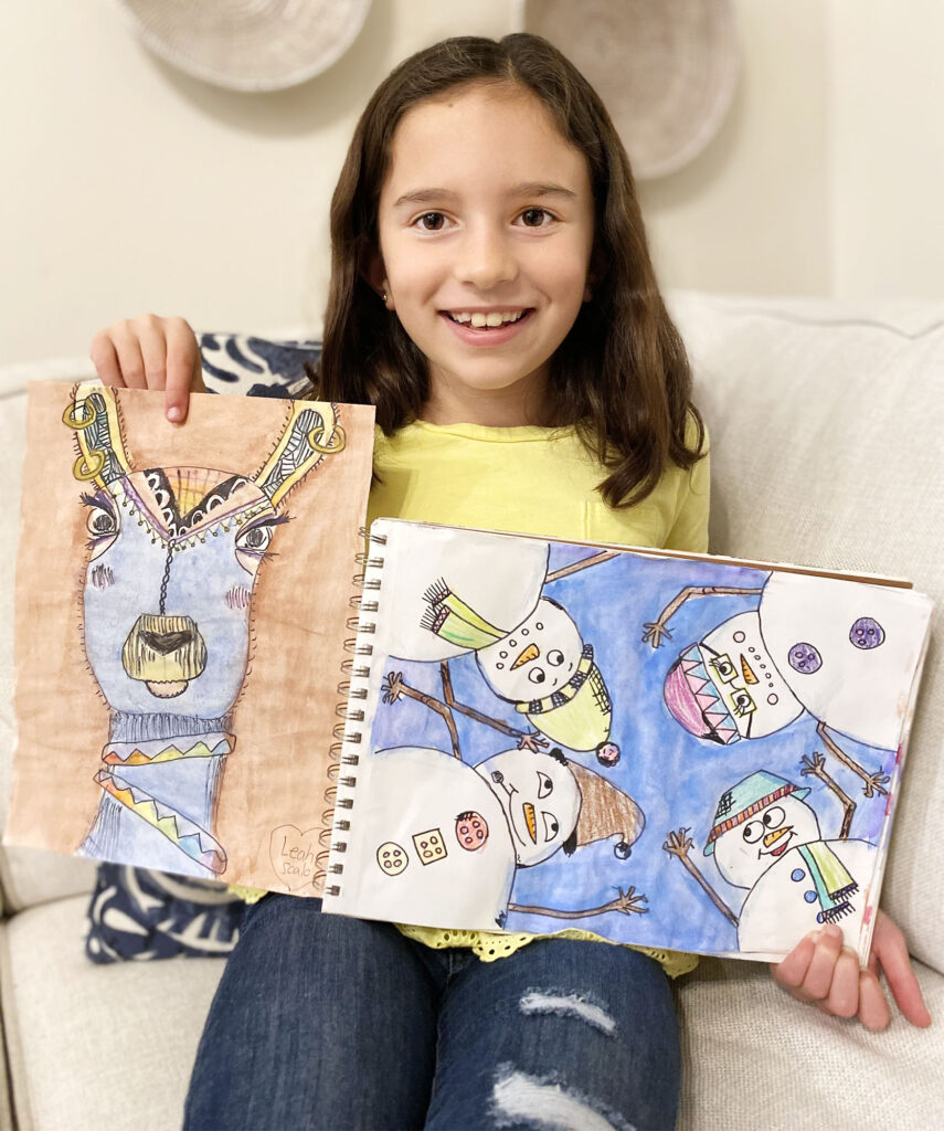Leah Scalo and two of her paintings