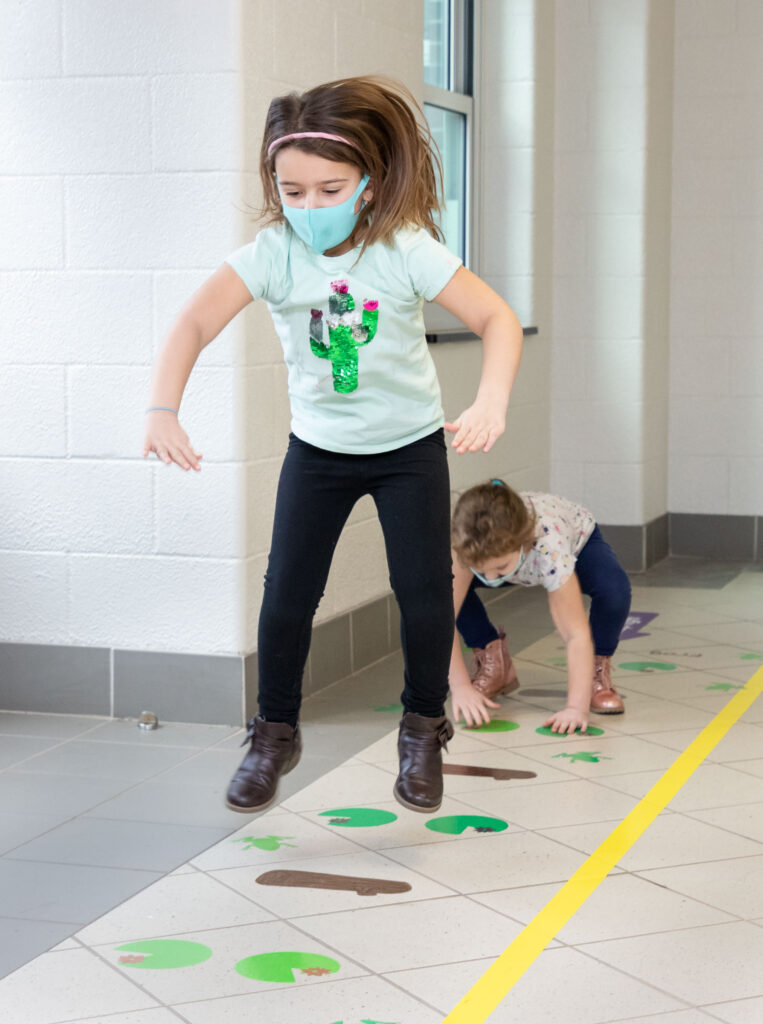 Kindergarteners use the new sensory path at Pine Island Elementary School on Jan. 22, 2021.