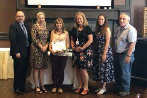 Dispatcher Carol Mindnich named 2021 Pupil Transportation Leader of the Year
