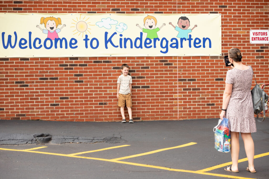 Student poses for a photograph at Pine Island Elementary School kindergarten orientation